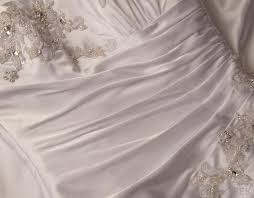 a close up of a plus size wedding dress