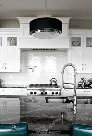 white contemporary kitchen with cambria ellesmere countertop on island off white subway tile backsplash