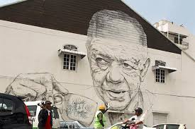 the old uncle with white coffee mural  on mural wall artist with artist splashes the walls around ipoh old town with his renowned