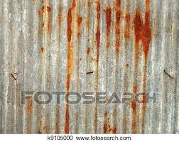 a rusty corrugated iron metal fence close up zinc wall rusted panels rust metal siding old rusty galvanized