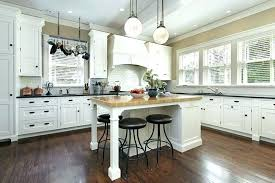 off white kitchen cabinets with wood countertops island butcher block countertop
