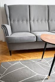 ikea strandmon grey sofa grey gislev rug and lovbacken side table