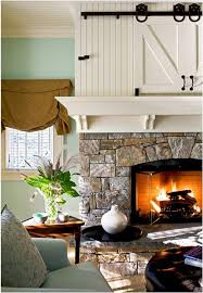 television behind barn doors in a mantel crisp architects