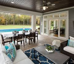 covered porch furniture. the backyard has a pool and screened in porch with phantom screens to open covered furniture