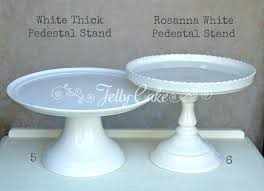 white pedestal cake plate stands labelled milk glass to hire
