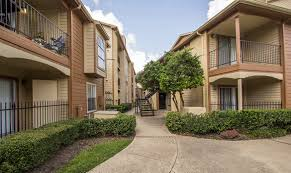 A walkway between apartments leads to stairs to second floor units at Mira  Bella Apartments on