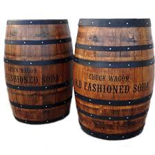 Refurbished old wine barrels with hand-painted company logo.