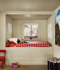Modern kids room featuring an alcove bed near the window