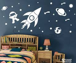 outer space wall decal sticker for nursery or home wall art decal features rocket stars shooting stars planets and astronaut great for on vinyl wall art boy nursery with outer space wall decal for baby boy nursery rocket planet stars