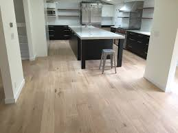 old world fallen timber hardwood floor with subway tiles kitchen backsplash industrial kitchen