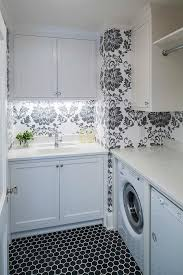 Black+and+white+laundry+room+features+walls+clad+