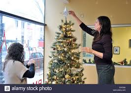office decoration for christmas. People Decorating, Christmas Tree Trimming In An Office CT USA Decoration For
