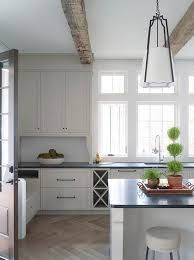 off white kitchen cabinets with light gray wash herringbone wood floor