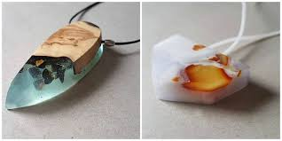 she combines olive wood with white blue transpa resin and amber to create the pendant on the left while white light violet resin is used in combination