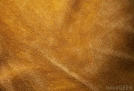 suede is a type of leather that has a fuzzy velvet like surface