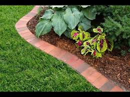 how to edge a garden bed with brick this old house