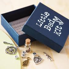 little dad kit showing open box with del of charms