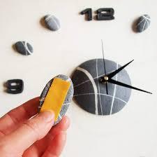 Orologio da parete stile moderno con effetto pietra linea sassi