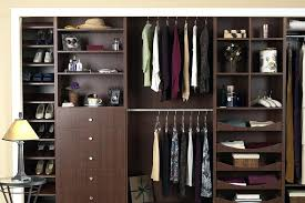customized closet reach in closet in chocolate apple finish with customized drawers custom closets toronto condo