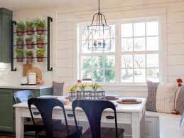 country breakfast nook with bench seating natural lighting and simple country table setting