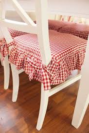 Wonderful cozy red gingham seat cushions add such charm to these chairs!  Red- February is American Heart Month & December is World Aids Month
