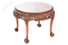quality walnut carved circular coffee table
