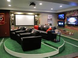 Sports man cave Modern Quintessential Sports Themed Man Cave With Rotating Stadium Seating Plush Chairs Facing Huge Projector Style Tv Home Stratosphere 101 Man Cave Ideas That Will Blow Your Mind photos