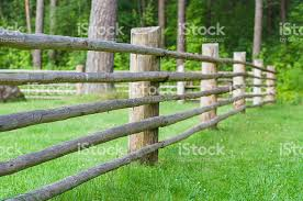 wooden farm fence. Rural Wooden Fence With Green Lawn, Part Of Farm Cattle-pen Royalty-free I