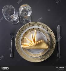 french fine dining table set up. table setting for fine dining or party cutlery and plate set up wedding celebration. french