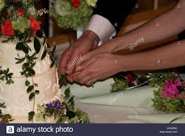 Hands On Design Cakes Bride And Groom With Their Hands On The Knife Cut The Cake