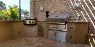outdoor kitchen with dryvit finish evo and memphis wood pellet grill