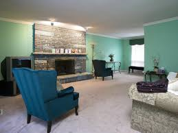 Wing Chairs For Living Room Bright And Simplistic Living Room With A Mint Sofa Green Wing
