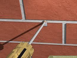image titled hang something on brick step 8
