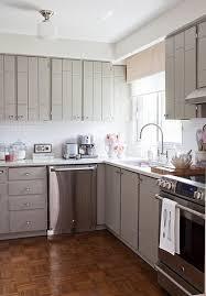 kitchens - gray kitchen cabinets white subway tiles backsplash schoolhouse  pendant chrome fixtures parquet wood floors