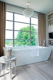 interior chandelier over bathtub contemporary bathroom kimberley seldon better impressive 7 chandelier over bathtub
