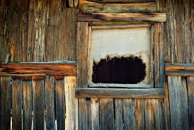 Old Window An Old Ripped Hessian Curtain In A Log Cabin Window Www
