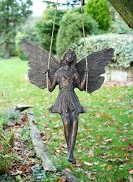 bronze fairy garden statues fairy on a swing garden ornament from garden snake baby