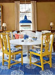 Beautifulclassicdiningroomwithrusticyellowwoodchairswhite - Dining room rug round table