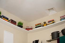 bedroom wall storage. Beautiful Wall Bedroom Storage Shelves Installed Along The Perimeter Of A Wall On Bedroom Wall Storage O