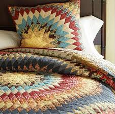 A Few Beautiful Quilts | The Pioneer Woman & Sunburst Quilt at Pottery Barn. I love this pattern…and I love the colors. Adamdwight.com