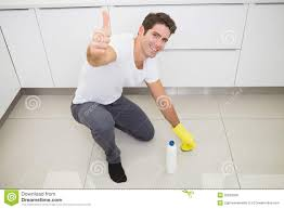 Kitchen Floor Cleaners Man Cleaning The Kitchen Floor While Gesturing Thumbs Up Royalty