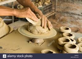 Image result for pictures of man working with clay