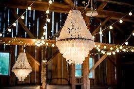 a romantic rustic barn wedding with chandeliers spring fls ashleigh braden