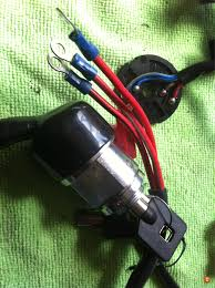ignition wiring problem this is a pic of the ds ignition the original in the background so yes the original has 4 wires and the new one only has 3