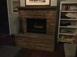 limewash or whitewash stone fireplace