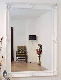 white decorative ornate wall mirror