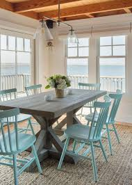 coastal dining room with beachy blue dining chairs