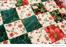 Holidays: Christmas Quilt - Stock Image I1171095 at FeaturePics & Holidays: Hand crafted homemade quilt of red and green with very fine  quilting stitches displayed Adamdwight.com