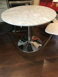 description less than one year old round marble table