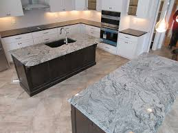 viscont white granite kitchen islands contrasting with dark granite counters